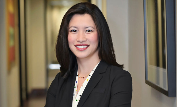 Lisa S. Tsai, a partner in Austin's Reid Collins & Tsai