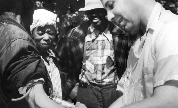 "A doctor draws blood from a participant in the Tuskegee syphilis study. A federal government advisory panel subsequently would conclude the project was ""ethically unjustified."""