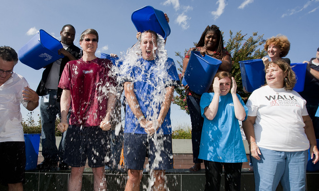 Venable attorneys and others participate in the Ice Bucket Challenge on the rooftop of the firm's D.C. offices.