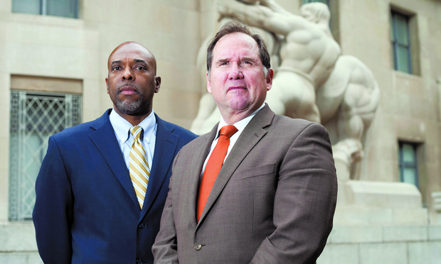 TRIAL: LabMD's Michael Daugherty, left, and his lawyer, William Sherman II, at the FTC