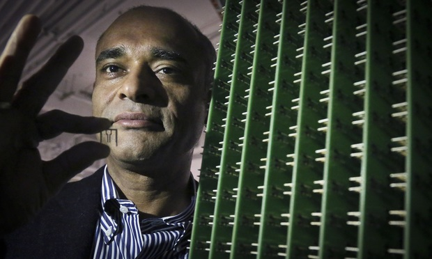 Aereo chief Chet Kanojia displays his company's antenna and an antenna block.