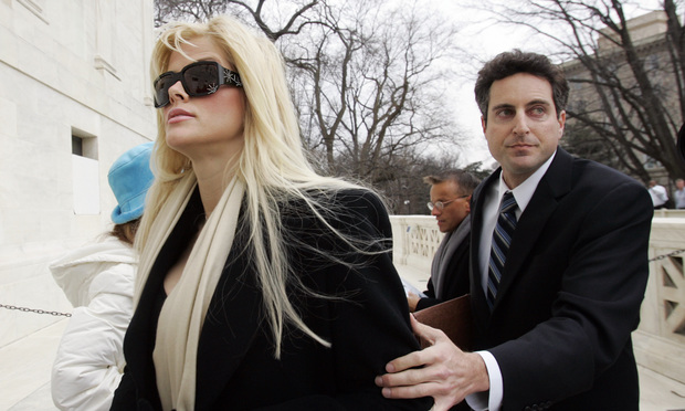 Anna Nicole Smith, left, arrives at the U.S. Supreme Court with her attorney Howard K. Stern, Tuesday, Feb. 28, 2006, in Washington.