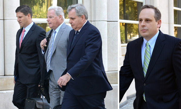 Defense lawyers Brett Ingerman, Shand Stephens and Anthony Coles of DLA Piper, left, walk into Brooklyn federal court Aug. 14 for opening arguments in Linde v. Arab Bank . Gary Olsen, right, is representing the victims of two dozen Hamas attacks and their families.