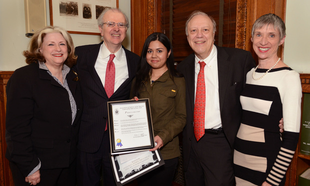 Rubaya Yeahia, center, winner of the annual high school essay contest sponsored by the Association of Supreme Court Justices, displays her award at a ceremony honoring 10 finalists at the New York City Bar Association on Monday. Joining the event were, left to right, Administrative Judge Sherry Klein Heitler; Chief Judge Jonathan Lippman, who announced the awards; Yeahia, a senior at Stuyvesant High School; Appellate Division, Second Department, Justice Robert Miller, who runs the awards program, and Kris Fischer, editor-in-chief of the New York Law Journal.