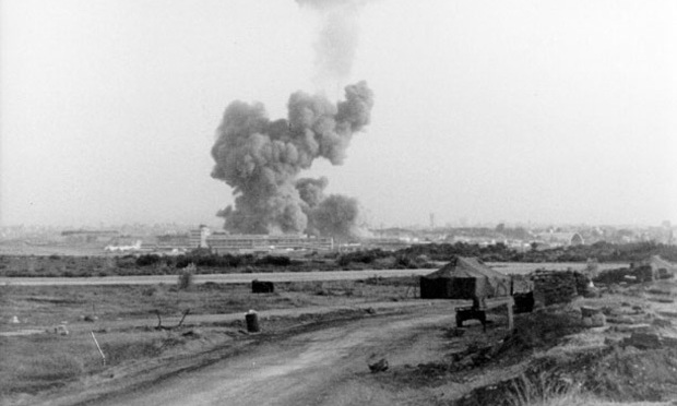 A smoke cloud rises from the rubble of the bombed barracks at Beirut International Airport in October 1983.