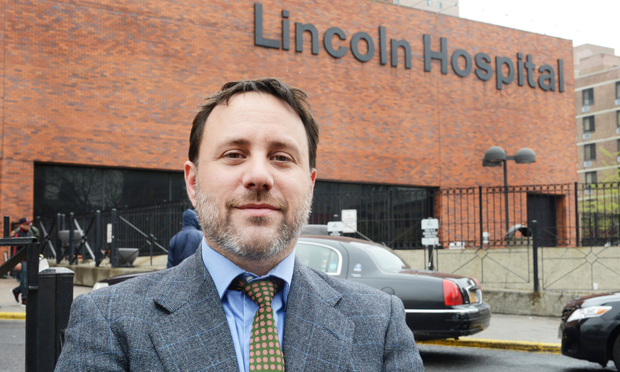 Jason Biafore, an attorney with the New York Legal Assistance Group, in front of Lincoln Hospital in the Bronx.