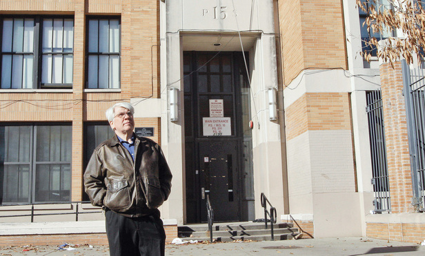 Bronx Household of Faith co-pastor Robert Hall stands in front of P.S. 15/P.S. 291 in the Bronx, where the church held services, in December 2011.
