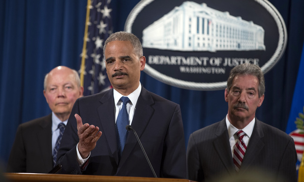 U.S. Attorney General Eric Holder, center,  announces the plea agreement with Credit Suisse AG Monday in which the European bank agreed to pay about $2.6 billion in penalties. Joining Holder at the Justice Department news conference were IRS Commissioner John Koskinen, left, and Deputy Attorney General James Cole.