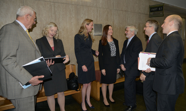 Defense attorneys confer outside a Manhattan state courtroom before  a hearing Friday on criminal charges against former Dewey & LeBoeuf leaders. From left: Elkan Abramowitz and Dana Delger, both from Morvillo Abramowitz Grand Iason & Anello; Kathryn Gebert, Anne Redcross and  Austin Campriello, all from Bryan Cave; and Marc Weinstein and David Shanies from Hughes Hubbard & Reed.