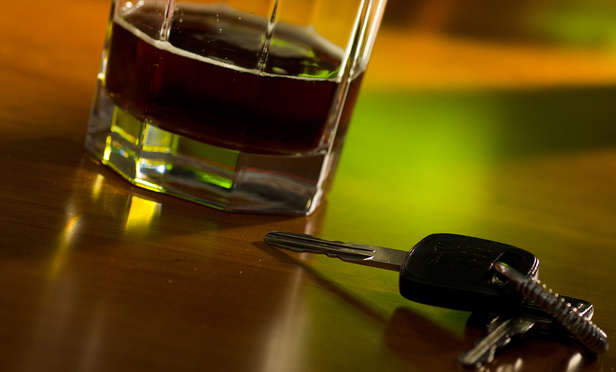 An alcoholic drink next to car keys