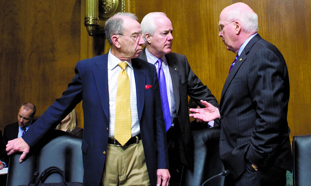 PARTISAN: Republicans Charles Grassley and John Cornyn, from left, and Democratic judiciary chairman Patrick Leahy, right, commenced finger-pointing after Leahy pulled patent-reform legislation.