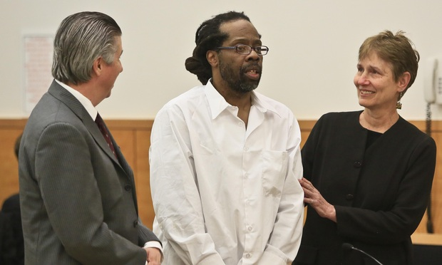 Robert Hill, center, stands with his lawyers Harold Ferguson and Sharon Katz as Justice Neil Firetog vacates his murder conviction Tuesday. He is one of three half-brothers whose decades-old convictions were vacated. Hill was the only one still incarcerated. One brother was on parole and the third had died in prison.
