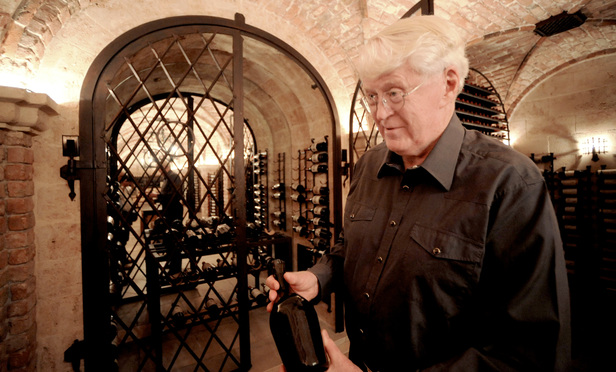 William Koch, in the wine cellar of his home in Palm Beach, Fla. in 2009, holds a bottle of wine once thought to belong to Thomas Jefferson. Koch subpoened nonparties in connection with his suit, claiming he was sold counterfeit rare wine by Rudy Kurniawan through Acker, Merrall & Condit, a New York-based dealer.