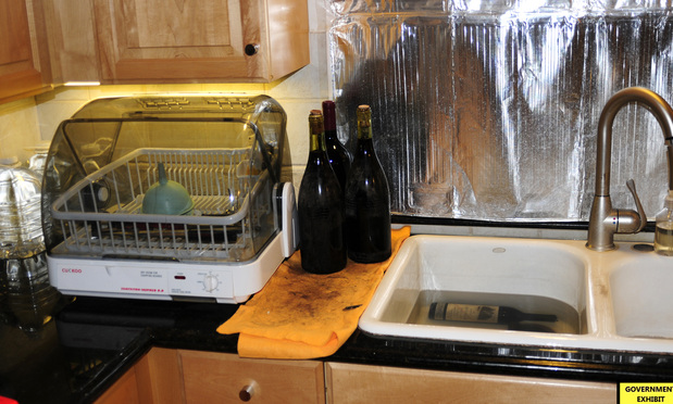 Amongst other evidence at trial, the U.S. attorney provided photos of Rudy Kurniawan's kitchen sink window being covered so he could allegedly soak wine labels he printed to make them look vintage.
