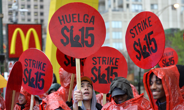 Fast food workers and community activists call for a $15 per hour wage during a demonstration outside of McDonald's flagship restaurant on May 15, 2014 in Chicago.