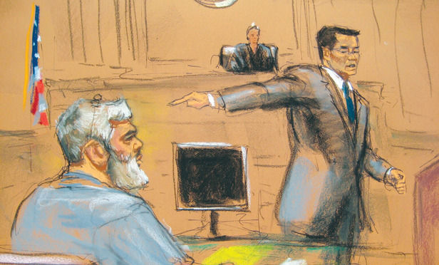 Assistant U.S. Attorney Edward Kim points towards Musfafa Kamel Mustafa, the radical Islamist cleric facing U.S. terrorism charges, during opening statements before Southern District Judge Katherine Forrest Thursday.