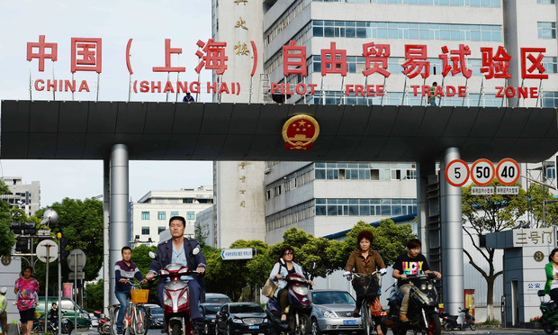 A sign showing the Pilot Free Trade Zone at the Waigaoqiao Bonded Area on September 26, 2013 in Shanghai, China.