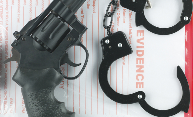 a revolver, an evidence bag and a pair of handcuffs