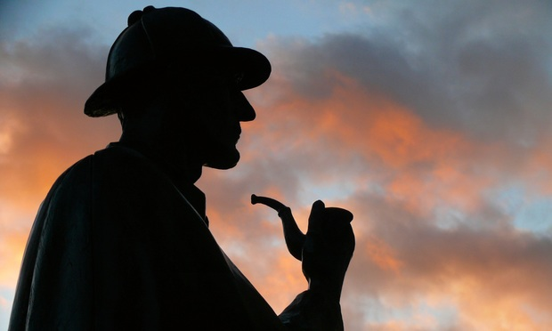 Evening silhouette of Sherlock Holmes's statue in London, England.