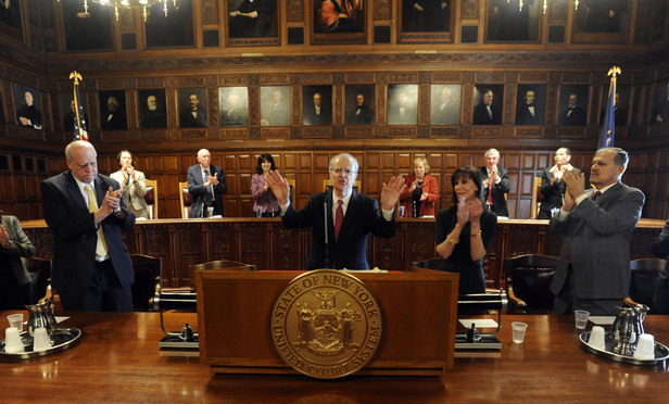 Chief Judge Jonathan Lippman, center, receives applause after delivering his State of the Judiciary address at the Court of Appeals in Albany, on Tuesday.