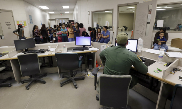 U.S. Customs and Border Protection agents process unaccompanied children in Brownsville, Tx. Officials say that the impact of the situation along the border will ripple through the entire nation's Immigration Courts, including an already overburdened facility in New York.