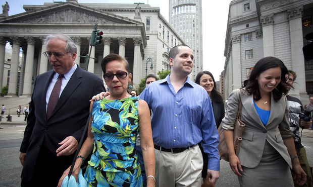 Former New York City police officer Gilberto Valle, second from right, and his mother, Elizabeth Valle, second from left, leave the Southern District courthouse Tuesday, flanked by his attorneys Edward Zas and Julia Gatto.