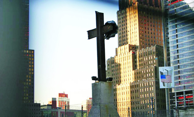 The 17-foot-tall cross-shaped beams installed on a pedestal at Ground Zero.