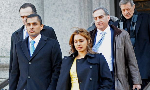 Mathew Martoma exits federal court with his wife Rosemary Martoma and attorneys Richard Strassberg and Roberto Braceras in New York, U.S., on Thursday, Feb. 6, 2014.