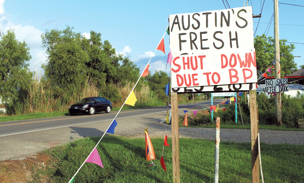 A sign announces the closing of a seafood stand due to the oil spill June 13, 2010 in Lafourche, Louisiana.