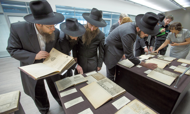 Visitors look through books in the library of the Schneerson family of Hasidic rabbis at the Jewish Museum in Moscow.