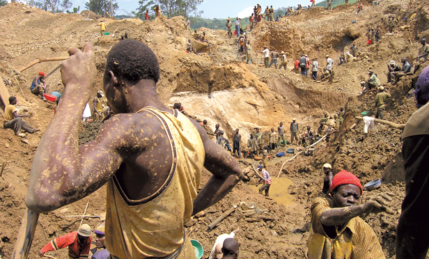 Artisanal miners dig for gold outside of Mongbwalu in the Democratic Republic of the Congo