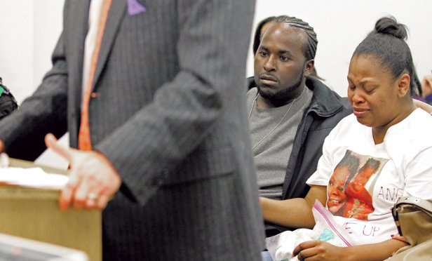 Nailah Winkfield, mother of 13-year-old Jahi McMath, right, is comforted by her husband Martin Winkfield and another family member as they wait for a hearing to startblah blah