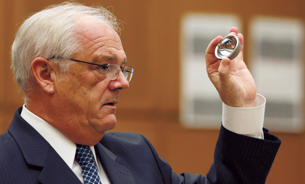 Michael Kelly, attorney for plaintiff Loren Kransky, holds up an ASR XL hip implant made by Johnson & Johnson during his opening statement to the jury at the trial of Kransky v. DePuy