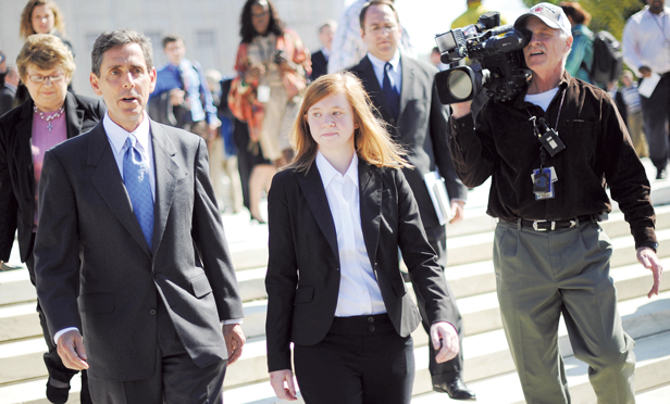 Abigail Fisher, center, plaintiff in Fisher v University of Texas and Edward Blum, left, director of the Project on Fair Representation outside the U.S. Supreme Court.