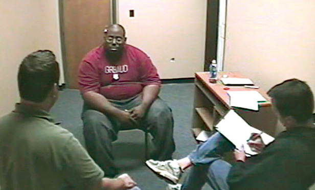 Adrian Thomas in the interrogation room of the Troy police station