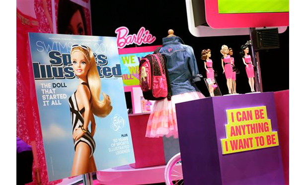 A mock-up cover of Barbie on a Sports Illustrated Swimsuit issue is displayed at the Mattel booth, Friday, Feb. 14, 2014 at the American International Toy Fair in New York.